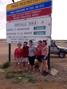 Girls at Birdville road sign
