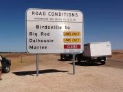 Big red road sign