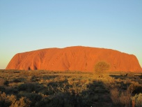 Uluru glows at sunset