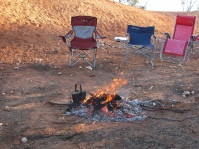Chairs around campfire