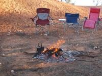 Chairs around campfire