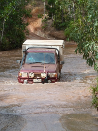 Crossing creek on Old Telegraph Track Cape York, landcruiser